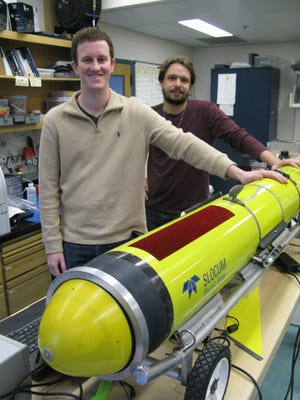 Rutgers University graduate students Greg Seroka, left, and Travis Miles launched a Slocum electric glider robot probe like this one to record ocean temperatures, currents and other information from the heart of superstorm Sandy. (Gannett, Kirk Moore/ Asbury Park (N.J.) Press)