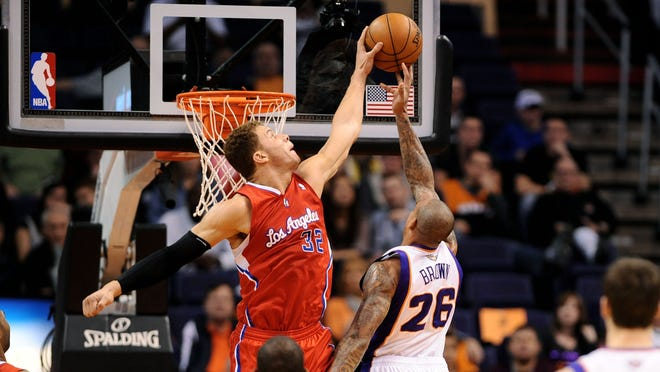 Clippers forward Blake Griffin (32) blocks a shot by Suns guard Shannon Brown (26) in the first half of the Clippers' 103-77 win.