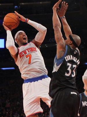 Knicks forward Carmelo Anthony (7) shoots over Timberwolves forward Dante Cunningham (33) during the fourth quarter.