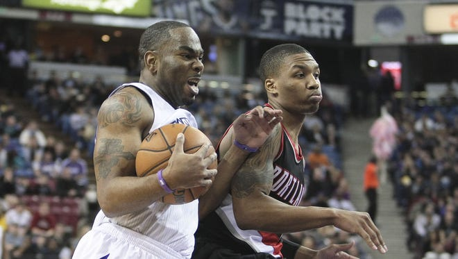 Kings guard Marcus Thornton, left, drives to the hoop against Trail Blazers guard Damian Lillard during the third quarter of Sacramento's 108-96 win.