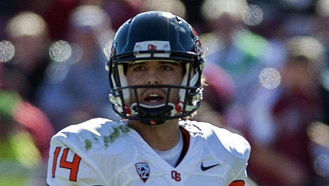 Oregon State quarterback Cody Vaz (14) looks to the sideline during the second quarter of a loss at Stanford on Nov. 10.