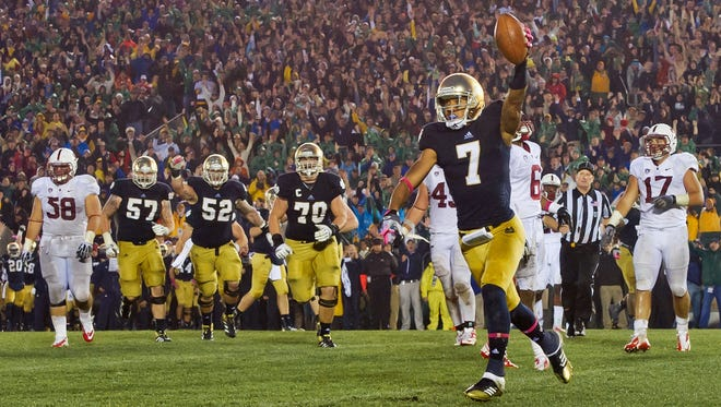 Notre Dame wide receiver TJ Jones (7) celebrates after a touchdown catch in overtime against Stanford at Notre Dame Stadium. Notre Dame won 20-13 on Jones's catch, which kept the Fighting Irish on a path to national title berth. Jones's late father Andre was a member of Notre Dame's last championship team.
