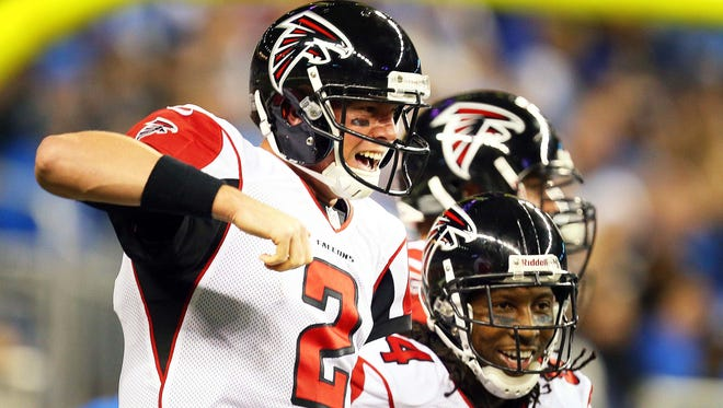 Falcons wide receiver Roddy White, right, and quarterback Matt Ryan (2) celebrate a touchdown during Saturday night's win over the Lions.