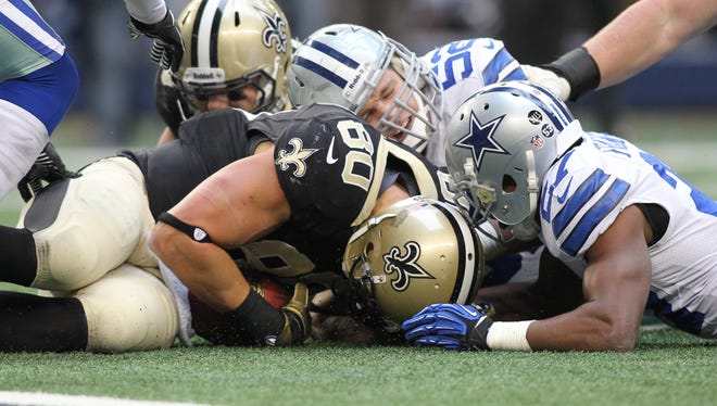 Saints tight end Jimmy Graham grabs a fumble in overtime, setting up the game-winning field goal.