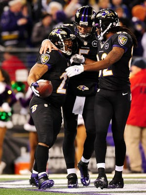 Torrey Smith and Joe Flacco congratulate Ray Rice after his second-quarter touchdown catch.