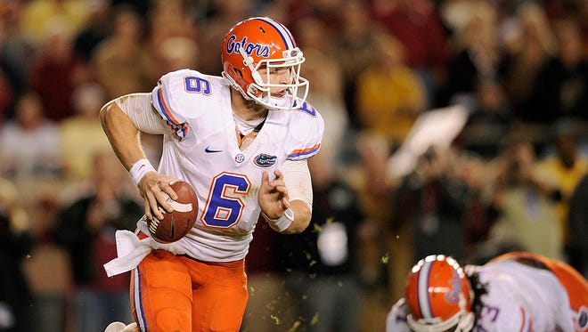 Florida Gators quarterback Jeff Driskel maneuvers in action against the Florida State Seminoles during the second of Florida's 37-26 win earlier this season.