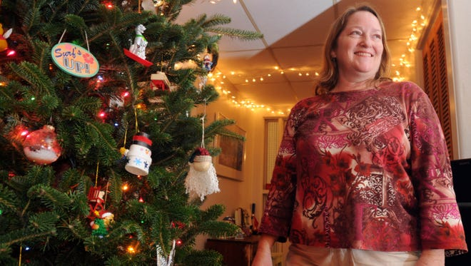 Linda Crumbaugh of Melbourne, Fla., enjoys a childhood tradition of walking through her neighborhood looking at Christmas lights. She continues the tradition today with her family.