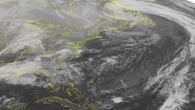 This NOAA satellite image taken Dec. 24, 2012, shows a low pressure system is moving across the Mississippi Valley into the southeastern United States with areas of rain and scattered thunderstorms.