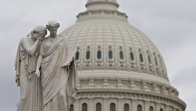 """Gray skies cover the U.S. Capitol in Washington on Friday as Congress closes down for the holiday without a compromise on the """"fiscal cliff"""" threatening the U.S. economy."""