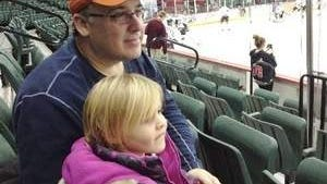 Steve Brescia, a Flyers season ticketholder from New Jersey, watches a Trenton Titans ECHL warmup with his 4-year-old daughter, Laurel.
