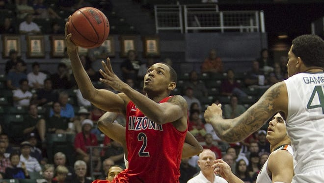 Arizona guard Mark Lyons (2), rolling to the basket for a first-half layup against MIami, scored 19 points to lead the Wildcats.