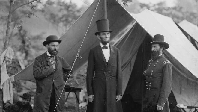 Allan Pinkerton, left, President Abraham Lincoln and Maj. Gen. John McClernand meet Oct. 3, 1862, after the Battle of Antietam.