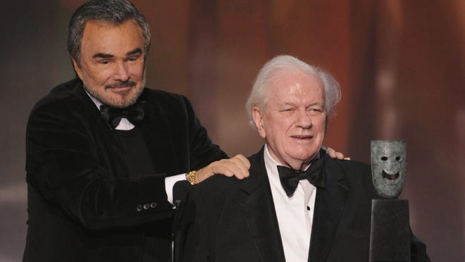 "Burt Reynolds presents Durning with the SAG lifetime achievement award. ""I was born a character actor,"" Durning told USA TODAY in 1990."