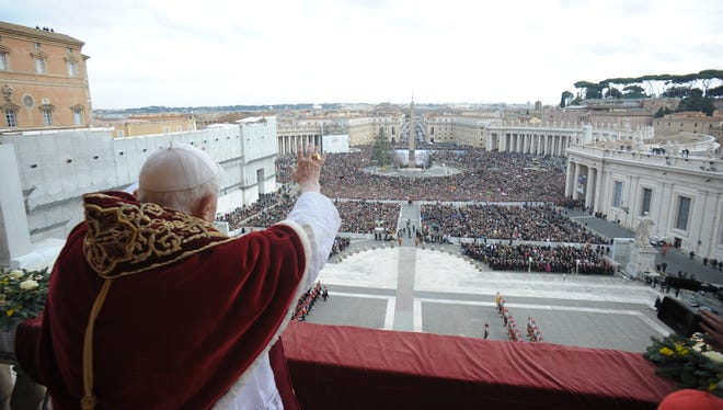 "Pope Benedict XVI delivers his ""Urbi et Orbi"" (to the City and to the World) message from the central balcony of St. Peter's Basilica on Tuesday."