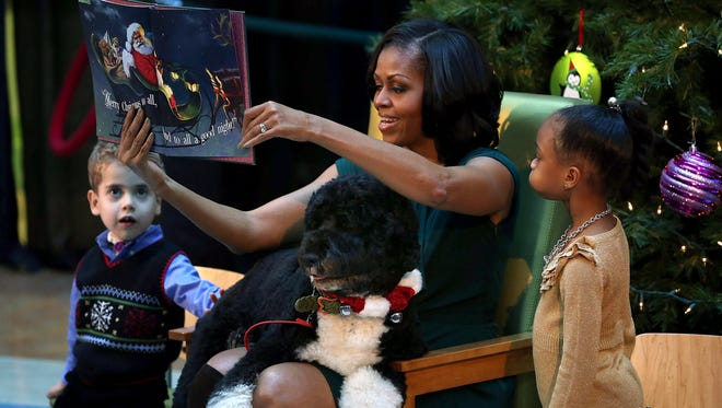 First lady Michelle Obama, joined by Bo, reads a Christmas story to children Dec. 18.