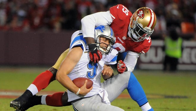 The 49ers' Aldon Smith, wrapping up the Lions' Matthew Stafford on Sept. 16, has 19 1/2 sacks this season and 33 1/2 in his two-year career.