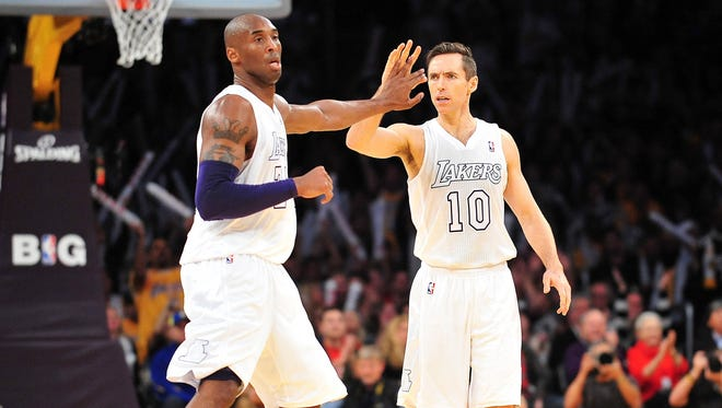 Lakers shooting guard Kobe Bryant, left, and point guard Steve Nash are starting to mesh well after just two games.