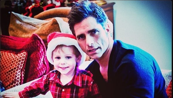John Stamos poses with his nephew, Frankie, on Christmas morning.