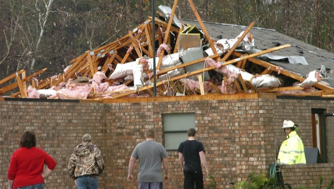 A house in Tioga, La., is severely damaged after an apparent tornado tore through the area Tuesday.