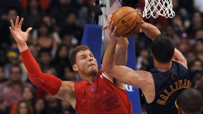 Los Angeles Clippers power forward Blake Griffin blocks a shot by Denver Nuggets small forward Danilo Gallinari in the first quarter at Staples Center.