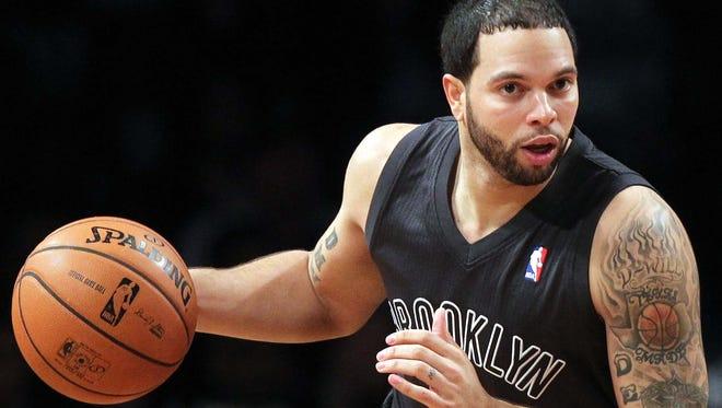 Brooklyn Nets guard Deron Williams (8) brings the ball up court against the Boston Celtics.