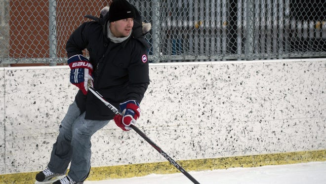 Montreal Canadiens defenseman Josh Gorges skates with the puck during a game of pick-up hockey in Montreal.