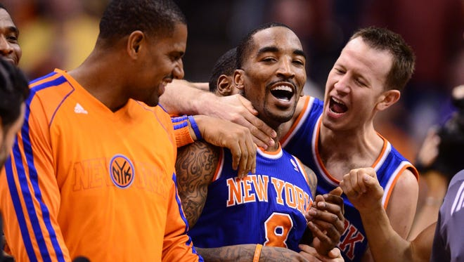 New York Knicks guard J.R. Smith (center) is congratulated by teammates after hitting the winning shot at the buzzer against the Phoenix Suns at the US Airways Center.