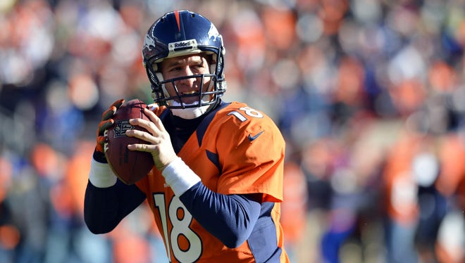 Denver Broncos quarterback Peyton Manning (18) during the first quarter of the game against the Cleveland Browns at Sports Authority Field.