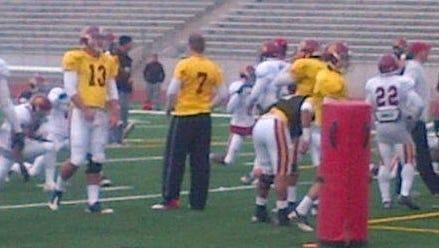 Matt Barkley (7) watches USC practice as the team prepares for the Sun Bowl against Georgia Tech.