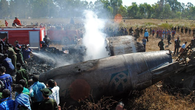 Rescue personnel work at the scene of an Air Bagan passenger plane crash near Heho airport.