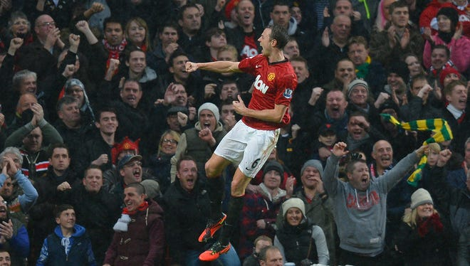 Manchester United defender Jonny Evans celebrates after scoring during the English Premier League match against Newcastle at Old Trafford in Manchester,  England, on Wednesday.