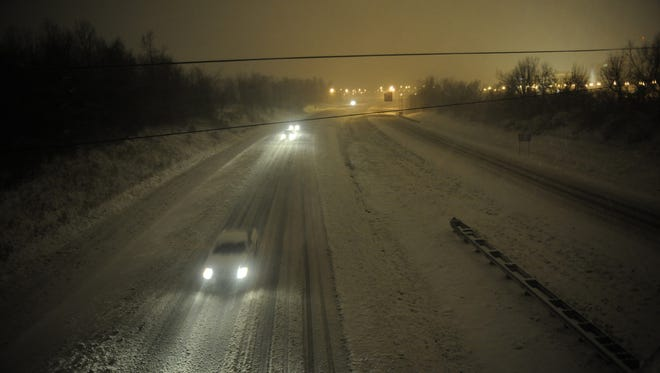 Motorists travel slowly on a snow-covered Interstate 24 during a winter storm Wednesday in Paducah, Ky.