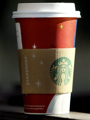 A Starbucks beverage cup. Message to come.