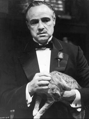 Marlon Brando stars as Don Vito Corleone in 'The Godfather.' Mario Puzo's estate has settled with Paramount over copyright infringement.