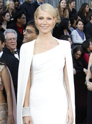 Gwyneth Paltrow stunned at the Oscars in a white Tom Ford column gown topped with a cape.