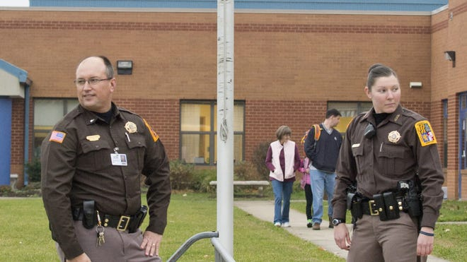 Sheriff's officers stand outside an elementary school Dec. 17 in Frederick, Md.