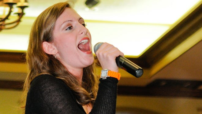 Aubrey Ireland sings a tune for guests at the Kenwood Country Club Tuesday, April 24, 2012.