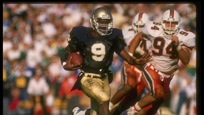 Notre Dame quarterback Tony Rice takes off in a 1988 victory against Miami (Fla.) en route to the Irish's last national championship.