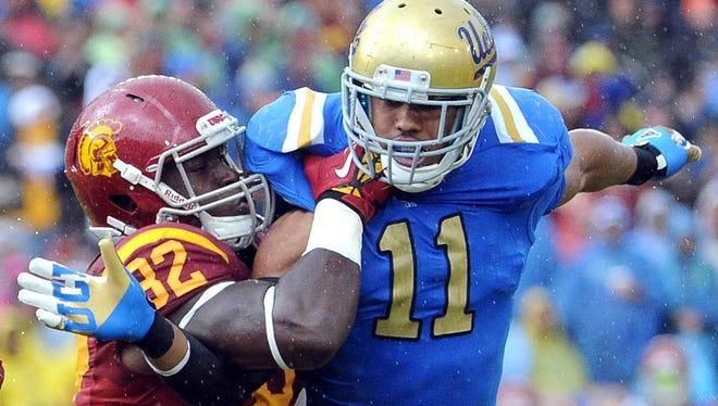 The pressure exerted by UCLA linebacker Anthony Barr, here being blocked by Southern California tight end Randall Telfer, will be key against Baylor QB Nick Florence, who leads the nation in total offense.