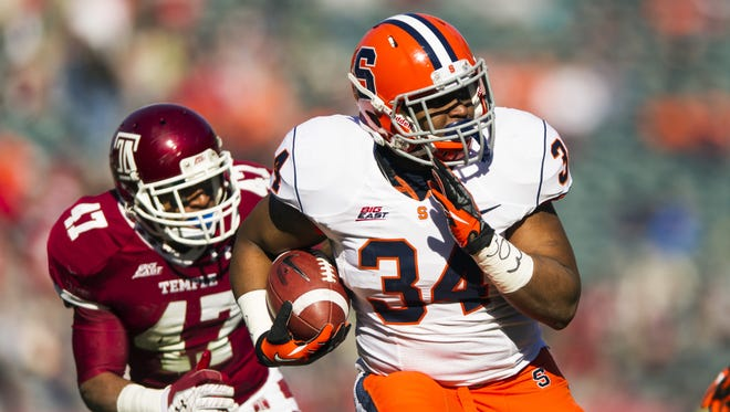 Syracuse tailback Adonis Ameen-Moore (34), scoring a touchdown against Temple during their Nov. 23 game, gained 108 yards on 30 carries and scored six touchdowns in the six games he played this season.