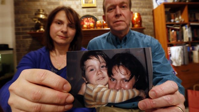 Natalia Zimina and her husband, Mike Sweeney, are trying to adopt Constantin, a 4-year-old Russian boy.