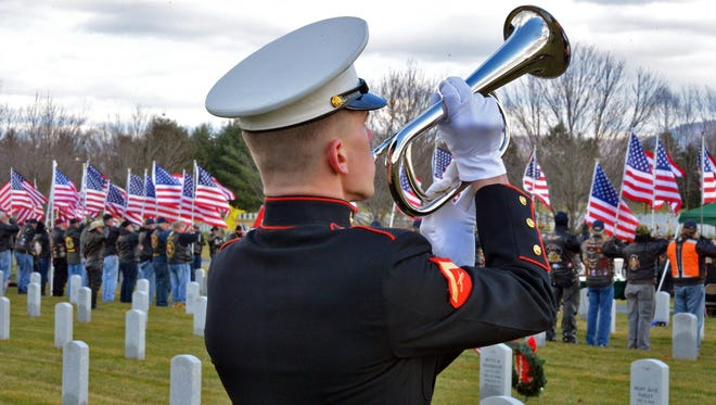 A Marine honor guard plays 'Taps' during ceremonies Dec. 11, 2012, for Marine Lance Cpl. Anthony Denier at Saratoga (N.Y.) National Cemetery.