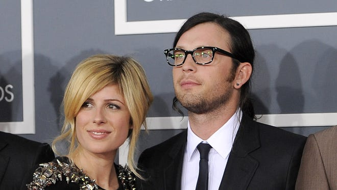 This Feb. 12, 2012 file photo shows Jessie Baylin with her husband  Nathan Followill from The band Kings of Leon at the 54th annual Grammy Awards in Los Angeles.