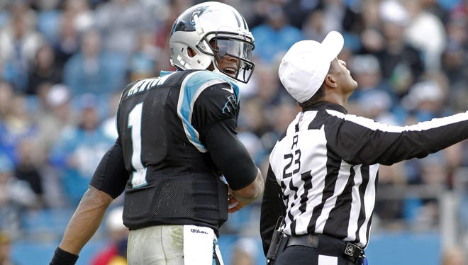 Referee Jerome Boger calls an unsportsmanlike conduct penalty on Panthers quarterback Cam Newton during the second half last Sunday's game against the Raiders.