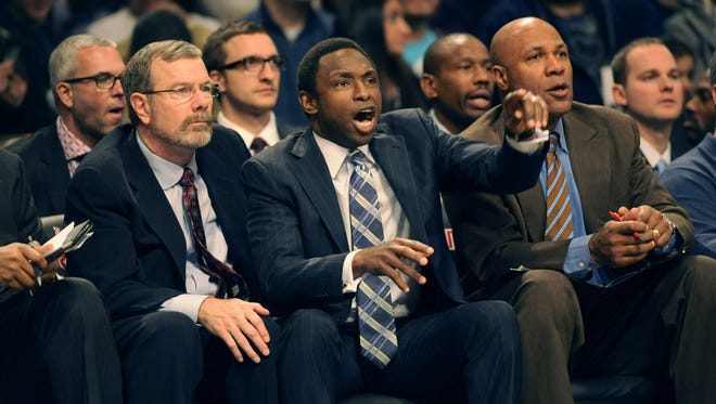 Brooklyn Nets' coach Avery Johnson, right, was fired and replaced by assistant P.J. Carlesimo, left.