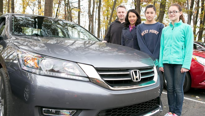 The Girvin family with a 2013 Honda Accord Left to Right: Patrick, Raquel and Cecilia Girvin, and Jessie Goldenberg, a family friend.