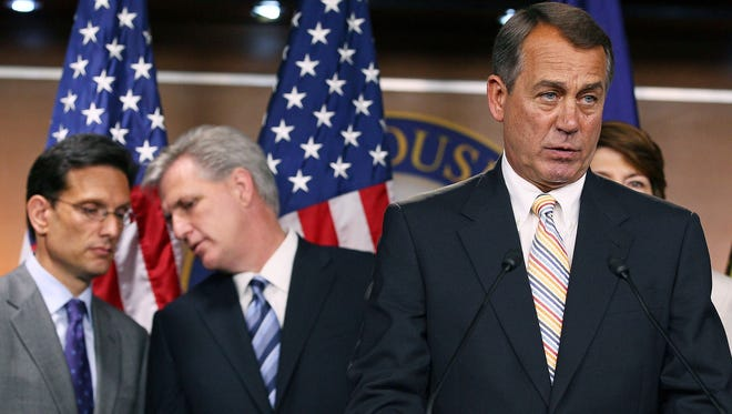 House Speaker John Boehner speaks, while Majority Leader Eric Cantor (R-VA) (L), and Majority Whip Kevin McCarthy (R-CA) stand behind him during a 2011 press conference about the Cut, Cap and Balance plan.