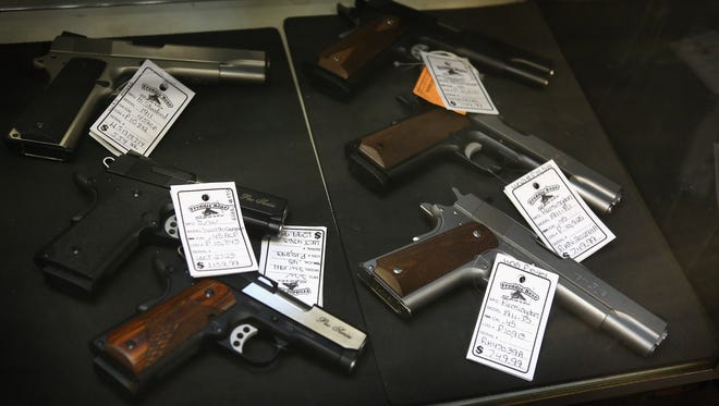 Pistols are offered for sale Dec. 17 in Tinley Park, Ill.
