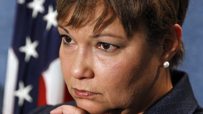 Environmental Protection Agency  Administrator Lisa Jackson listens during a news conference at the National Press Club in Washington on Oct. 21, 2010.