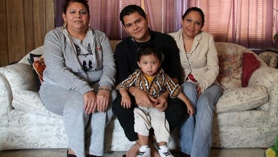 Omar Mex Valle of Denison — sitting with his mother, Rosa Valle, 1-year-old nephew D'Angelo Mex, and sister Yuliana Mex — has already received an Iowa driver's license, but DOT officials say they will inform him his license is not valid in the wake of Thursday's decision. He is originally from Mexico.